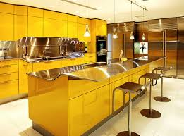 nice yellow mexican kitchen with hardwood cabinets also decorative cheerful yellow themed kitchen with ultra modern island with metallic countertop design