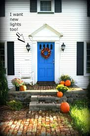 what color front door goes with a dark gray house cream red brick