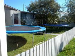this small front yard has three trampolines in it mildlyinteresting