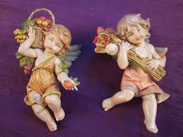 pair of fontanini simonetti italy cherub four seasons wall