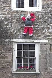 santa clause themed outdoor decorations dot