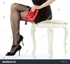 beautiful legs young woman sitting on stock photo 97316633