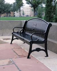 manchester vertical slat arched back memorial bench with cast iron