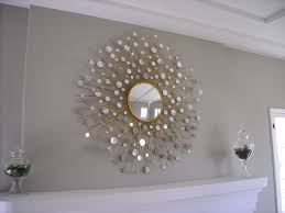 decorating gold sunburst mirror plus double table lamp and white