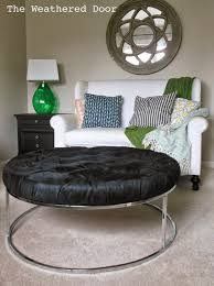 Black Tufted Ottoman A Round Black Tufted Ottoman With A Chrome Base The Weathered Door