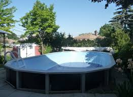 contemporary backyard design with oval esther williams swimming