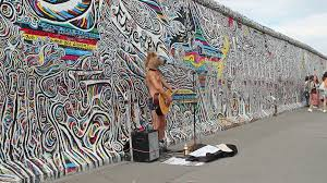 man with horse head is playing guitar at the berlin wall germany man with horse head is playing guitar at the berlin wall germany stock video footage videoblocks