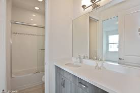 stormy gray cabinets w quartz counters add style to this jack jill