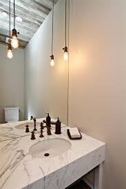 splashy edison light fixtures in hall contemporary with bathroom