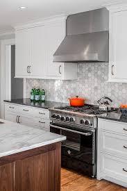 white kitchen cabinets with hexagon backsplash marble hexagon tiles with black bluestar range