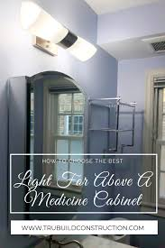 how to put lights above cabinets how to choose the best light for above your medicine cabinet