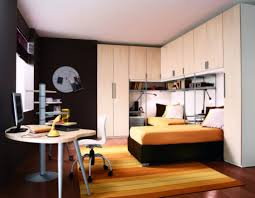 teen room nueva linea s ways of defining amazing teens bed rooms beautiful contemporary boys room design ideas with l shaped cabinets integrated with closet and bookshelf also orange striped rug a collection of exciting