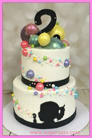 candy bubbles two tier cake with blowing bubble silhouette and