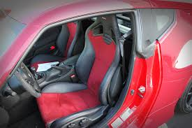 nissan 370z how many seats behind the wheel 2015 nismo 370z review stillen garage