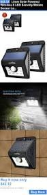 Solar Security Motion Sensor Light by Two Solar Powered Led Lights On Adjustable Brackets Provide Motion