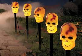 lawn stakes for lights make no bones about it skeletons are in this halloween