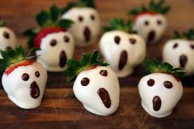 ghost face painting for halloween halloween white chocolate dipped strawberry ghosts halloween
