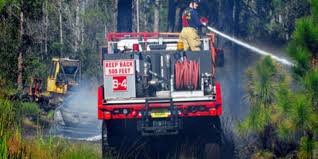 Wild Fires Near Merritt by Day After Storm Brush Fires Persist In Brevard