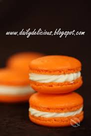 dailydelicious orange macaron with cream cheese filling playing