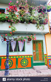 colorful house with flowers in guatape antioquia in colombia