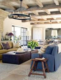 navy blue sofa and wooden beam ceiling for rustic farmhouse living