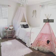farmhouse style pink and white vintage little girls room decor