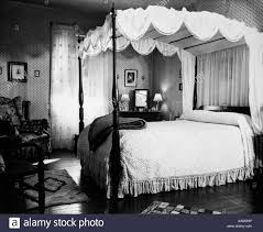 1940s bedroom with canopy bed u0026 chenille bedspread stock photo