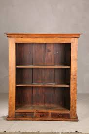 open hanging cupboard curly maple with three small drawers and
