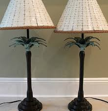 pair of exotic bombay company palm tree lamps with unique tile