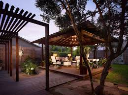 free standing patio cover porch contemporary with bushes elevated