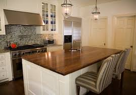 countertops classic modern kitchen with high end appliances and classic modern kitchen with high end appliances and wood kitchen countertop with circle undermount sink on white kitchen island and mosaic backsplash