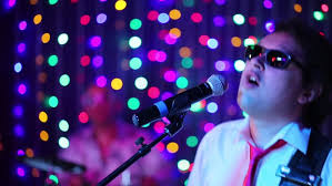 Singing Christmas Tree Lights Man Wearing Christmas Cap Uses Mobile Phone On A Christmas Tree