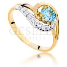 pierscionek zareczynowy nowoczesny pierścionek zaręczynowy z modnym topazem swiss blue i