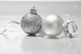 a silver of two baubles one sparkly one pearl