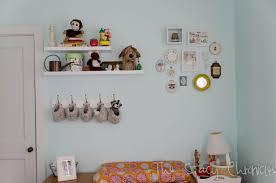 nursery wall shelf with hooks