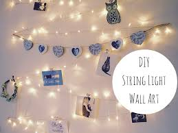 lights on wall with pictures diy string light wall art decoration