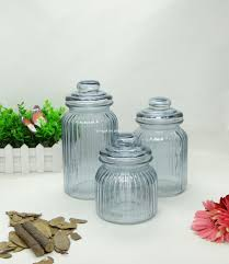 ribbed and knob topped clear glass kitchen storage jars with