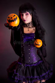 beautiful witch in purple gothic halloween costume stock image