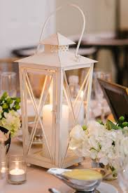 white lantern centerpieces white lantern and hydrangea centerpieces