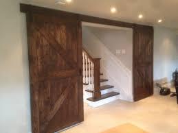 beautiful union jack biparting barn door for a basement