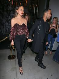 simple chrissy teigen holiday party to s from red carpet