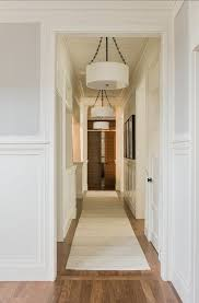 white dove paneling gray owl above light fixtures upstairs