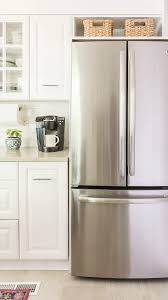 how to trim cabinet above refrigerator how to frame a refrigerator that is wide for opening