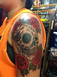 skull and roses on shoulder area pm
