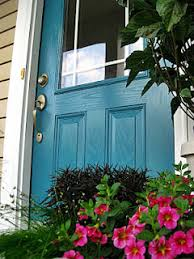 love the color of the door beige siding and black shutters