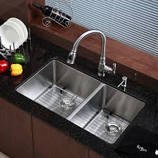 kitchen undermount sink with brown wooden floor and small glass