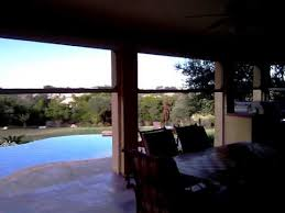 motorized retractable sun screens for your patio and outdoor
