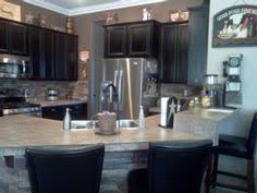why do kitchen cabinets cost so much better view of the pantry and wine fridge now kitchen remodel