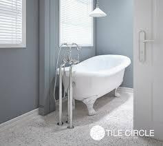grey tiles lead the way tile circle aspen white marble mosaic bathroom floor tile with claw foot bathtub