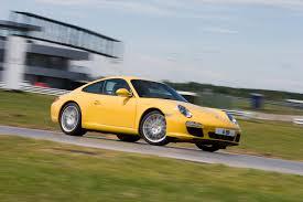 yellow porsche side view porsche 911 review 2004 2012
